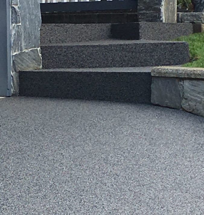 An entry stairway after rubber surfacing job completed by Vancouver Safety Surfacing.