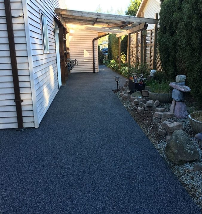 The after image of a home's side walkway after rubber surfacing done by Vancouver Safety Surfacing
