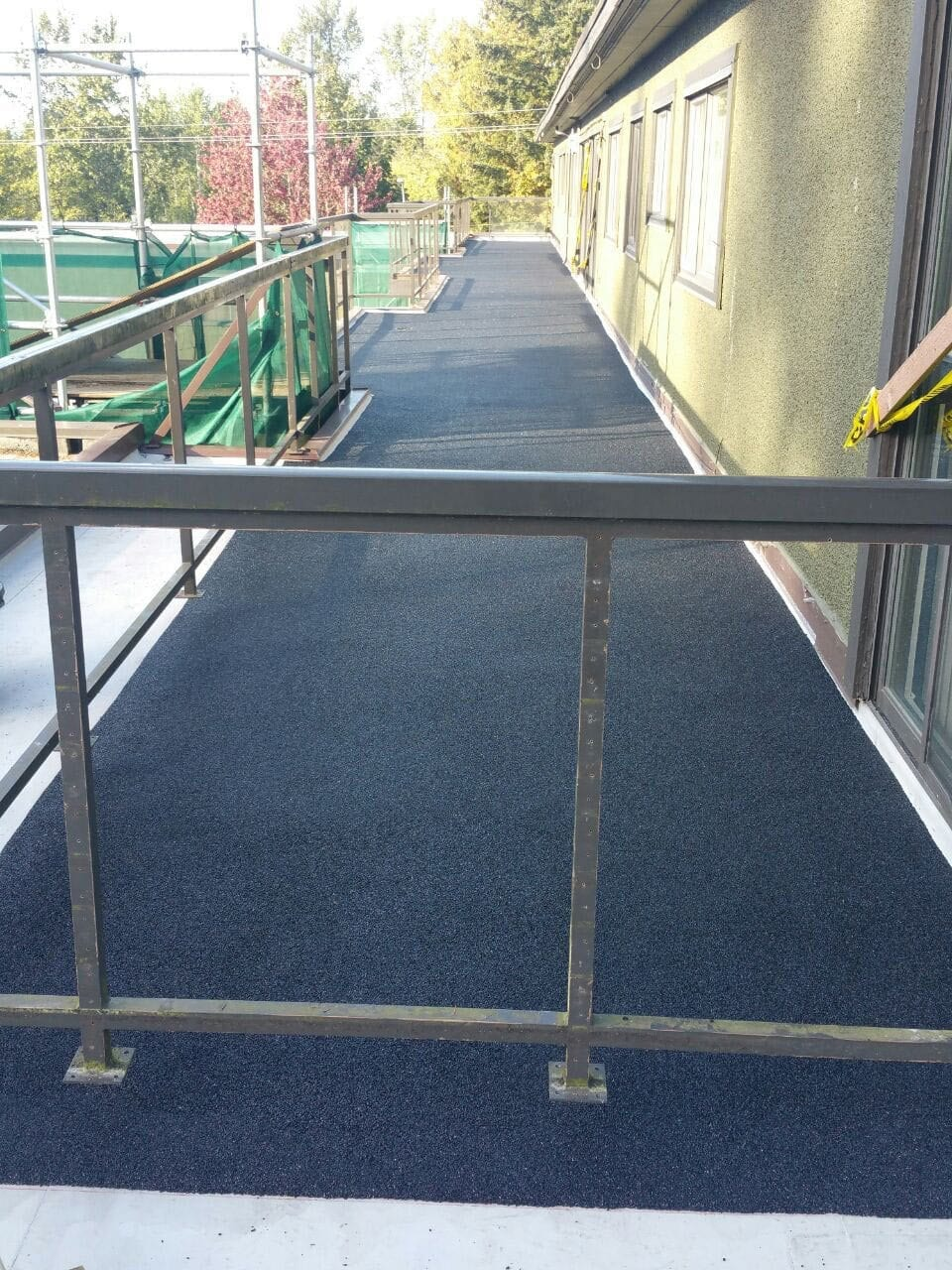 Roof with rubber surfacing